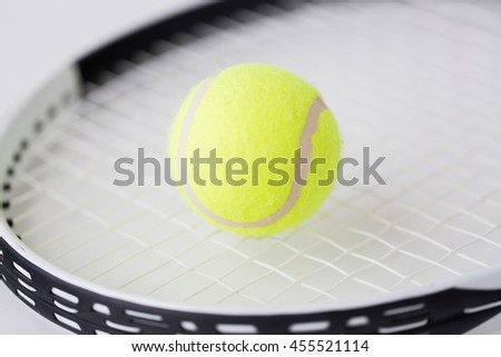 sport, fitness, healthy lifestyle and objects concept - close up of tennis racket with balls