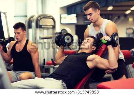 sport, fitness, lifestyle and people concept - group of men with dumbbells in gym - stock photo