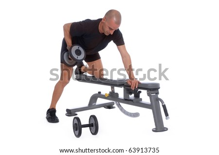 Sport Fitness trainer exercising in a table using dumbbells in gym, isolated over white background