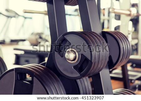 sport, fitness, weightlifting and health care concept - close up of gym machine