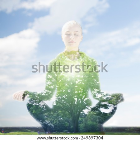 sport, fitness, yoga, double exposure and people concept - happy young woman meditating in lotus pose over blue sky and green tree background - stock photo