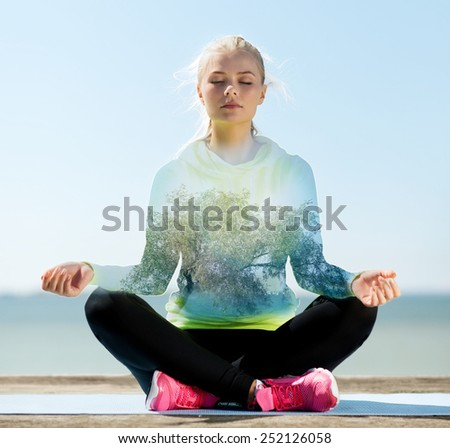 sport, fitness, yoga, double exposure and people concept - happy young woman meditating in lotus pose over blue sky with sea and tree background - stock photo