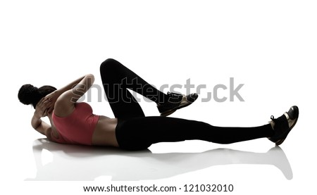 sport girl doing abs exercise, silhouette studio shot over white background - stock photo