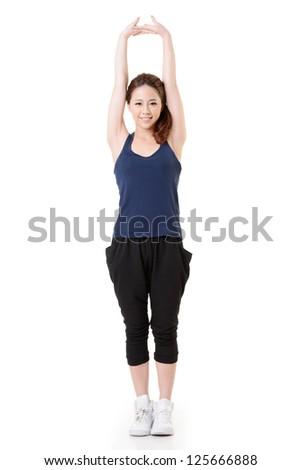 Sport girl of Asian doing stretch exercise, full length portrait isolated on white background. - stock photo