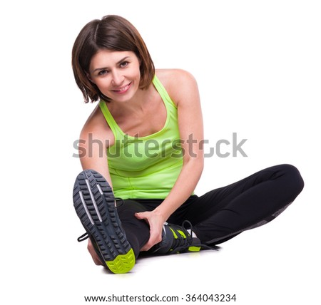 sport girl stretching on the floor - stock photo