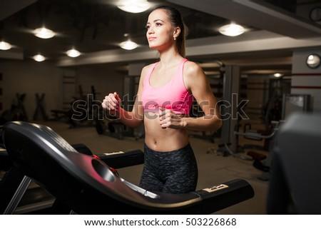 Busty women running on treadmills
