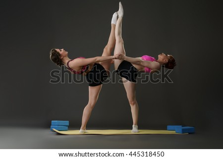 Sport. Gymnasts posing in pair during workout - stock photo