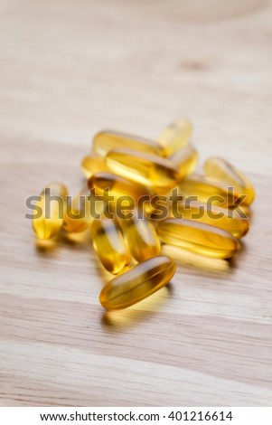 sport, healthy lifestyle, medicine, nutritional supplements and people concept, fish oil capsules - stock photo