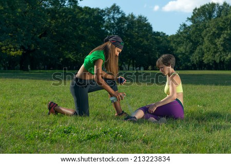 Sport injuries...Sports doctor giving first aid - stock photo