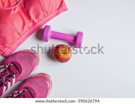 Sport lifestyle concept. Top view of dumbbells, sneakers and sport accessories on wooden desk. - stock photo