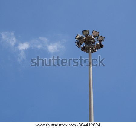 sport light on blue sky background with cloud - stock photo
