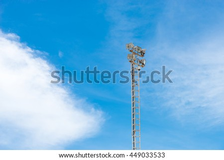 sport lights tower with blue sky background