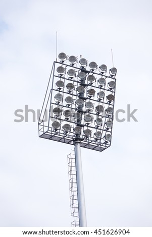 Sport lights with cloudy sky - stock photo