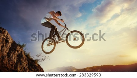 Sport. Motion biker jumps - stock photo