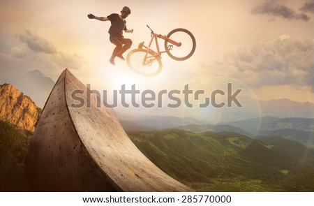 Sport. Motion biker jumps - stock photo