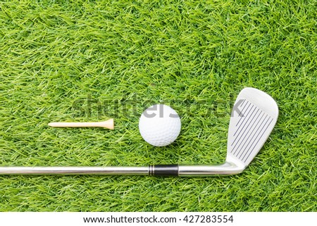Sport objects related to golf equipment ,Golf club and golf ball on green grass