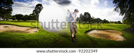 Sport Panorama Of A Vintage Golfer Hitting A Flying Golf Ball Mid Air On A Golfing Green In A Depiction Of Speed And Top Flight - stock photo