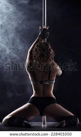 Sport. Pole dancer, woman dancing on pylon - stock photo