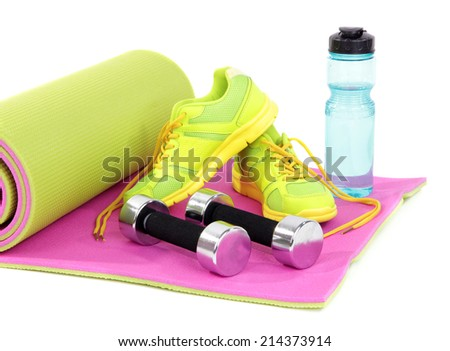 Sport requisites on a carpet isolated on white - stock photo