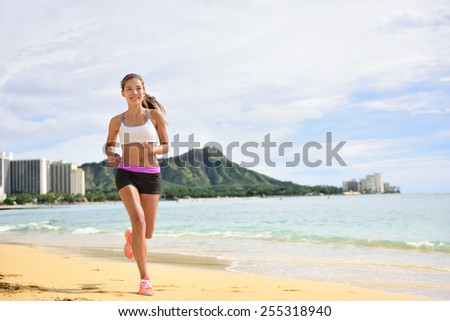 Sport running fitness woman jogging on beach run. Female athlete runner jogger training living healthy active exercise lifestyle exercising outdoor on Waikiki Beach, Honolulu, Oahu, Hawaii, USA.  - stock photo