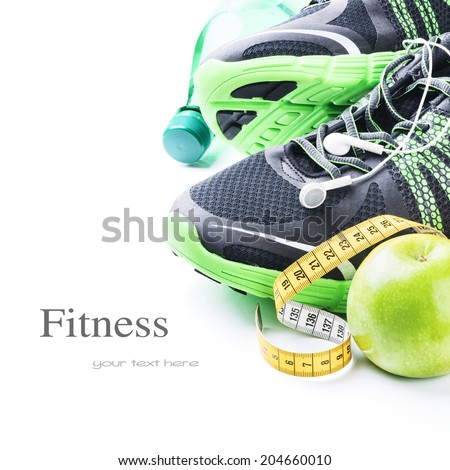 Sport shoes and green apple. Fitness concept - stock photo