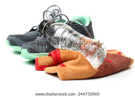 Sport shoes and gym accessories. Fitness concept - stock photo