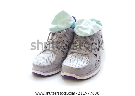 Sport shoes and socks isolated on white background - stock photo