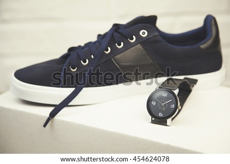 Sport shoes and watch on box, fitness running - stock photo