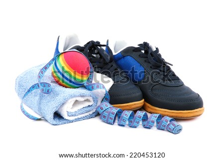 Sport shoes, equipment and measuring tape on a white background. - stock photo