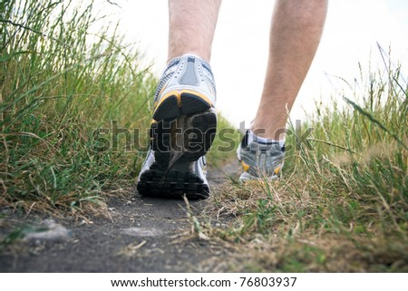 Sport shoes exercising in summer, walking concept. Motivation and inspiration outdoor adventure, run or walk outside for better health