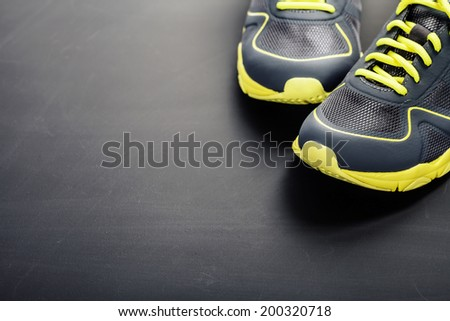 Sport shoes on grey background - stock photo