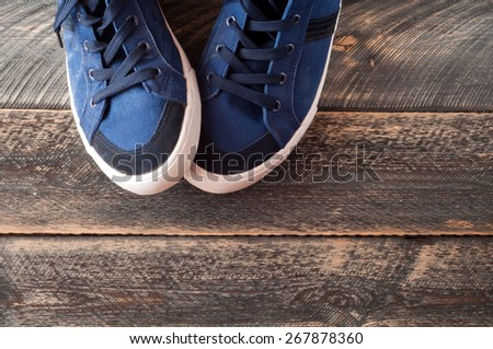 Sport shoes on old wooden background. Top view sneakers