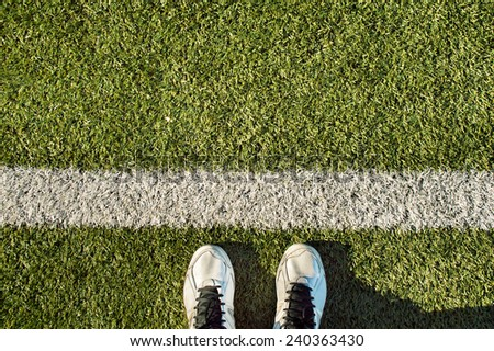 sport shoes on the grass with copy space - stock photo