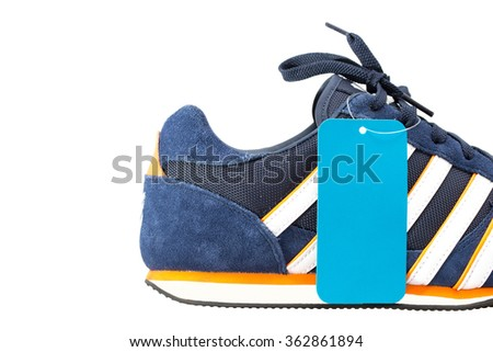 Sport shoes with price tag isolated on white background. - stock photo