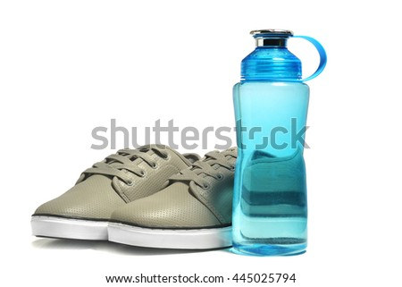 sport shoes, with water bottle on a white background