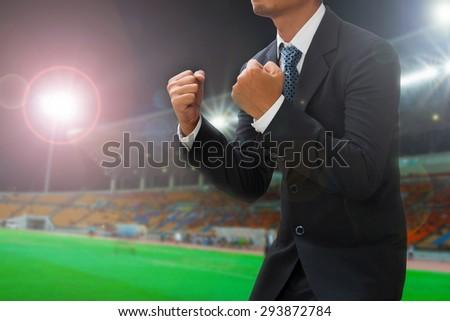 sport soccer manager celebrates his team's score in stadium - stock photo