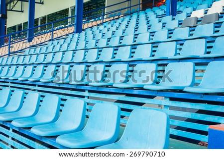 Sport stadium plastic chair on bleachers view row - stock photo