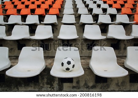 Sport stadium , soccer ball on chair - stock photo
