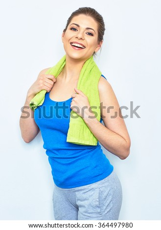 sport style portrait of happy smiling woman with green towel on shoulders isolated on white background. beautiful female model studio posing. - stock photo