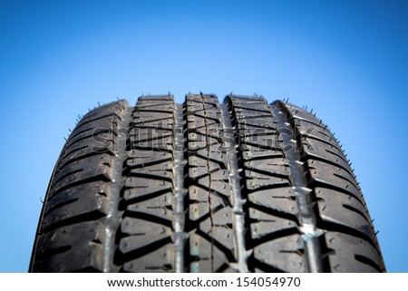 Sport summer tire isolated on blue background - stock photo