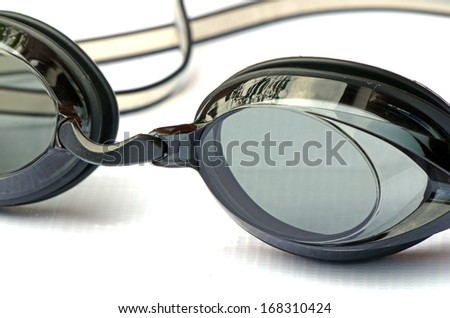 Sport swimming goggles on white canvas.