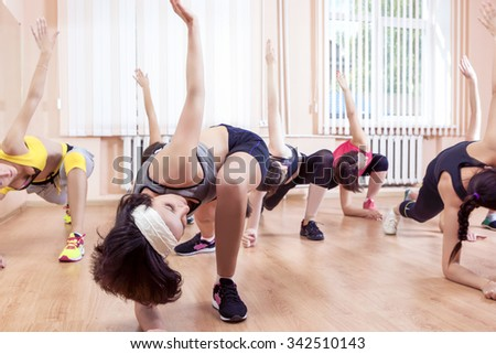 Sport, Training anf Healthy Lifestyle Concepts. Group of Caucasian Women Taking Part In Gym Fitness Class. Horizontal Image Orientation