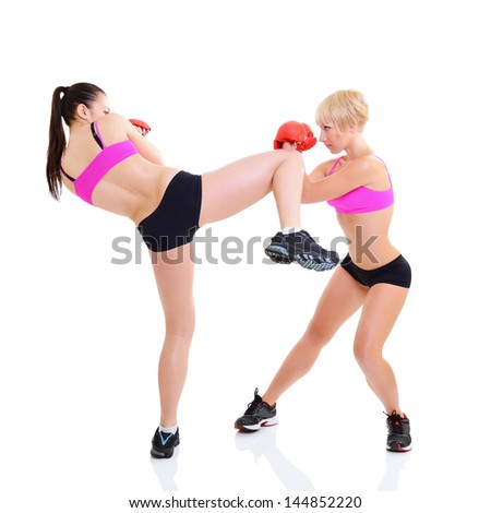 sport training of two boxing young woman, studio over white - stock photo