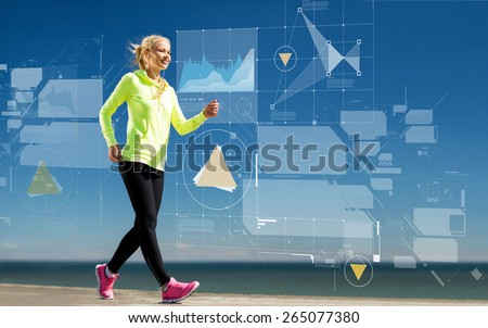 sport, training, technology and lifestyle concept - smiling young woman walking outdoors