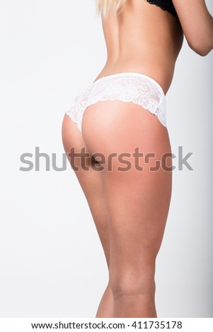 Sport trim pop with smooth skin. woman's pop in a white lacy panties. sexy ass, beautiful garter - stock photo