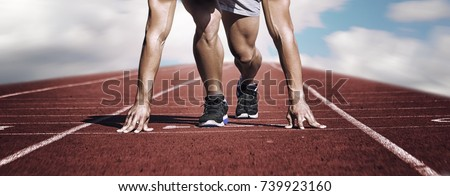 Sport. Unknown young runner on the start line. Horizontal. Blurred background
