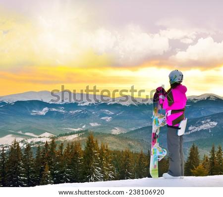 Sport woman in snowy mountains. Carpathian, Ukraine, Europe.   Snowboarder.  Bukovel. - stock photo