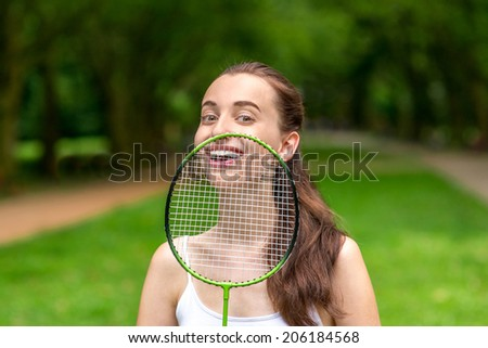 Sport woman playing badminton in the park - stock photo