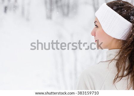 Sport woman running in winter. Female runner portrait in full body jogging in snow on cold winter day. - stock photo
