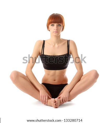 Sport woman sitting on the floor, isolated on white background